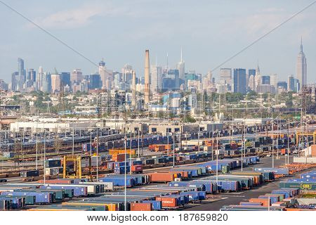 New York USA- May 20 2014. Cargo shipping containers with New York City view in background.