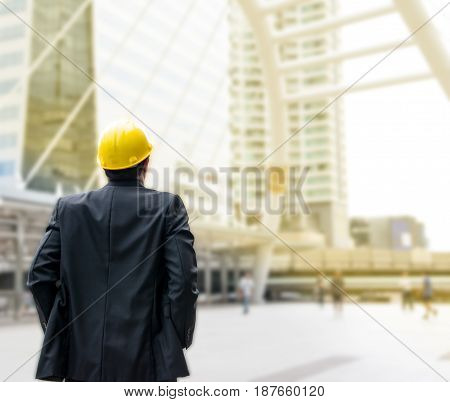 Business man focus on building in the city for success feeling with copy space