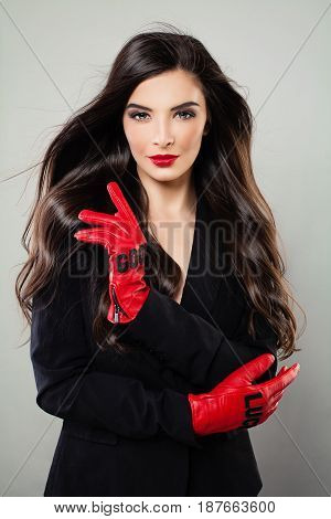 Beautiful Woman with Long Healthy Hair and Event Makeup. Cute Young Model with Fashion Hairstyle and Perfect Make up