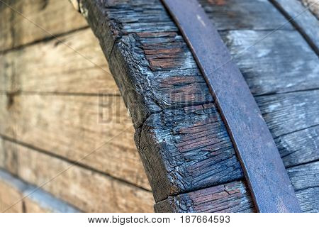 Corner of old wooden barrels with iron hoops