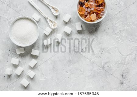 cooking sweets set with different sugar lumps on kitchen gray table background top view mockup