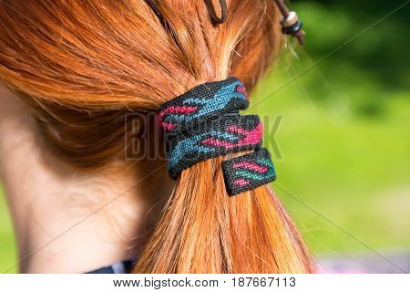 Closeup of beautiful hair accessories over red hair.