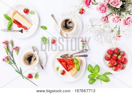 Flat lay with coffee, delicious homemade strawberry cheesecake and flowers over white. Top view.