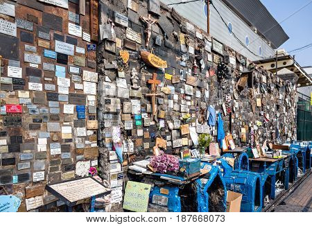 SANTIAGO CHILE - OCTOBER 28 2016: A place of street prayer made up of a dozen templates (hermitages) L' Animita de Romualdito.This is the most famous of the animitas of Chile.