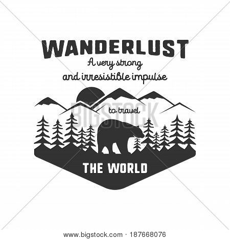 Vintage adventure hand drawn label design. Definition of wanderlust sign and outdoor activity symbols - mountains, forest, bear. Retro style. Isolated on white background. Vector letterpress effect.