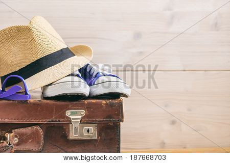 Travel Accessories On An Old Suitcase - White Background - Copy Space