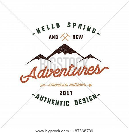 Vintage adventure Hand drawn label design. Hello spring and new adventures sign and outdoor activity symbols - mountains, climb gears. Retro colors. Isolated on white background. Vector