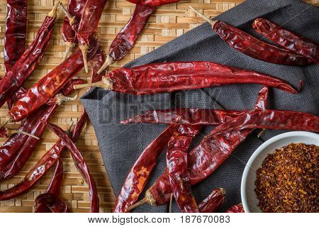 Top View Of Dry Red Chili And Chili Powder On Bamboo Basket