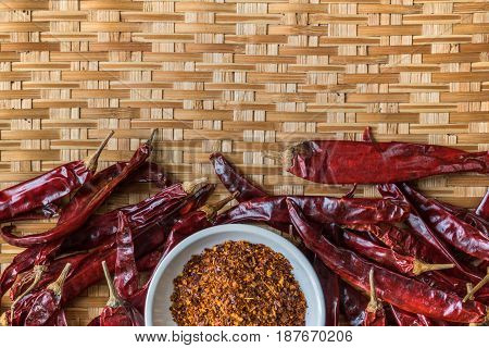 Top View Of Dry Red Chili And Chili Powder On Bamboo Basket With Copy Space