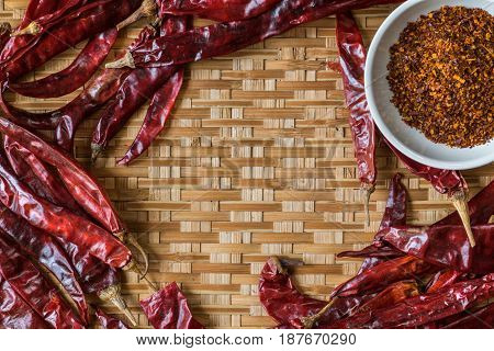 Top View Of Dry Red Chili On Bamboo Basket With Copy Space