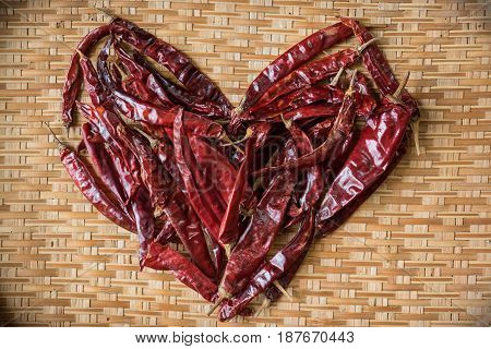 Heart Shape Of Dry Chilli On Bamboo Basket With Vignette