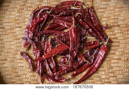 Top View Of Dry Red Chili On Bamboo Basket With Vignette