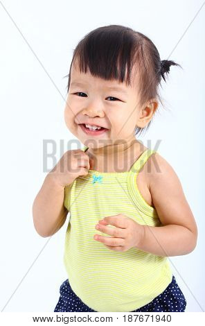 Portrait of little cute asian baby on a white background