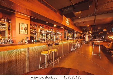 BANGALORE, INDIA - FEB 14, 2017: Club and bar of the Arbor Brewing Company waiting for customers at evening on February 14 2017. With population 8.52 million Bangalore is third most populous indian city