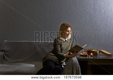 Young Woman Reading  Book .