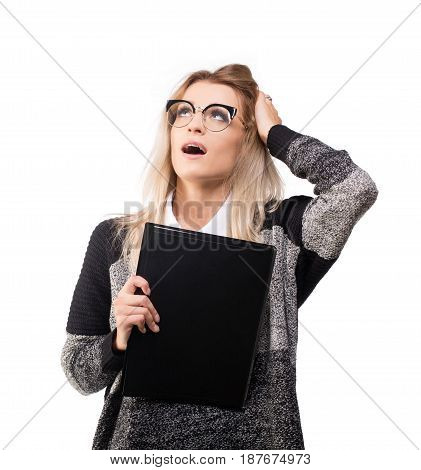 Shocked young business woman with black folder isolated on white.
