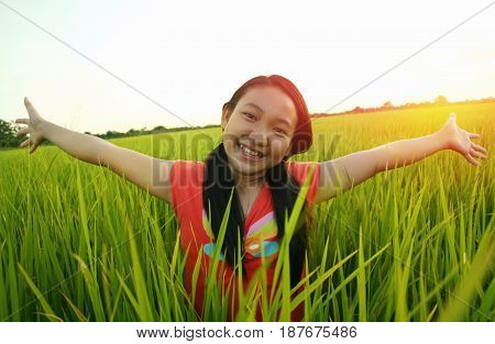 Freedom (asian kids children) little asian girl having a good time in the rice paddy field
