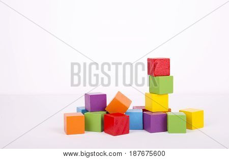 Toy blocks heap colorful wooden bricks stack over white background