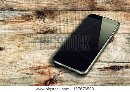 Realistic mobile phone with black screen and shadows on wooden background.
