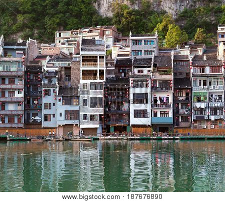 Zhenyuan Ancient Town on Wuyang river in Guizhou Province, China. It is under the administration of the Qiandongnan Miao and Dong Autonomous Prefecture