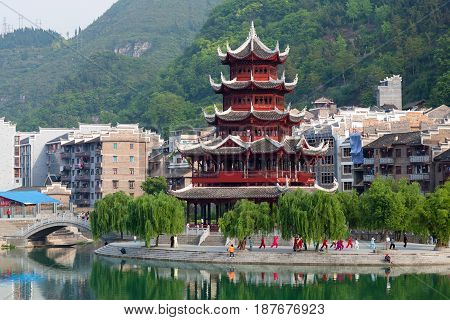 Beautiful pagoda in Zhenyuan Ancient Town on Wuyang river in Guizhou Province, China. It is under the administration of the Qiandongnan Miao and Dong Autonomous Prefecture