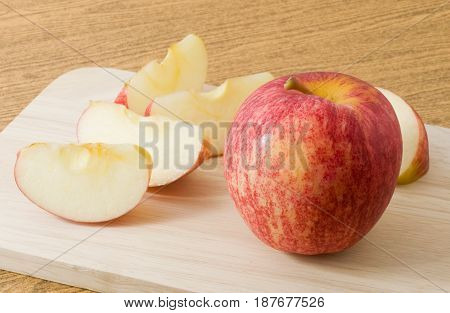 Fresh Fruits Ripe and Sweet Red Apple on Wooden Cutting Board.