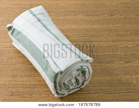 Kitchen Towel on Wooden Table with Copy Space for Text