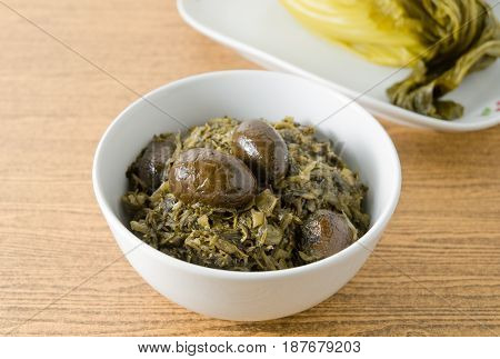 Chinese Traditional Food Chopped Pickled Chinese Cabbage with Chinese Olives in A Bowl.