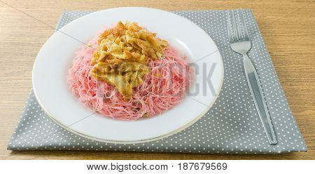 Thai Cuisine and Food Dish of Red Stir Fried Rice Vermicelli Topping with Julienne Omelet.