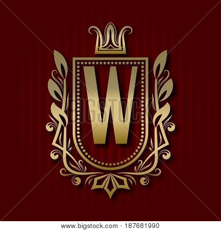 Golden royal coat of arms in medieval style. Vintage logo with W monogram.