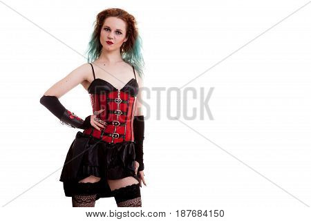 Beautiful BDSM model in leather corset isolated on white background in studio photo