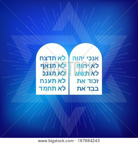Rock of ten commandments with Hebrew alphabet on blue background with star of David and ray of light