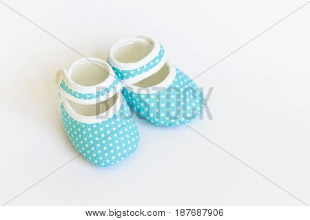 Blue slippers Baby shoes for newborns on isolated background