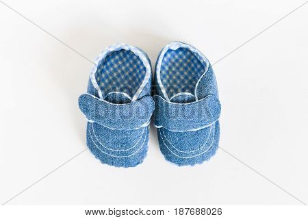 Denim slippers Baby shoes for newborns on isolated background