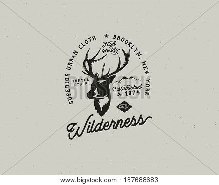 Hand drawn vintage camping badge and hiking label with hiking design elements and typography. Included deer head, mountains and quote text- wilderness . Old style patch. Rustic patch vector template.
