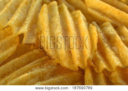 Chips pattern. Yellow salted potato chips as background. Chips texture studio photo.