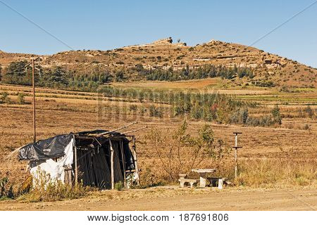 Abandoned Roadside Farm Stalls On Cold Dry Winter Landscape