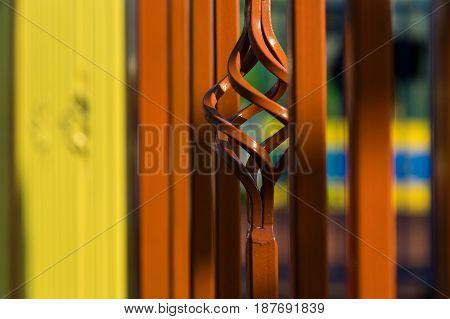 A sample of beautiful forging patterns on a metal fence and a fence