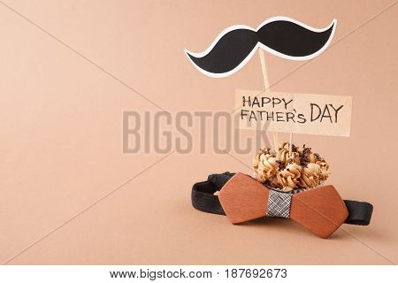 Fathers day background with copy space, cupcake, bow tie and mustache with greeting card