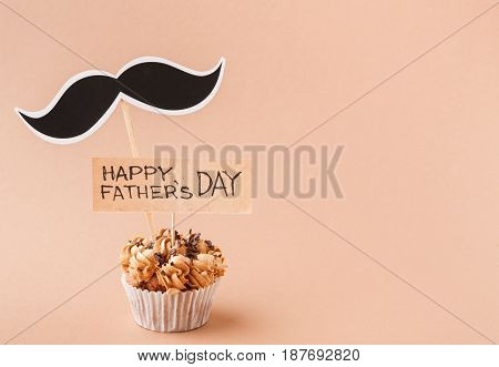 Fathers day background with copy space, cupcake and mustache with greeting card