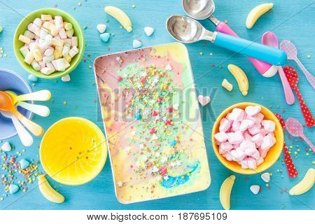 Colorful unicorn ice cream and sugary sprinkles