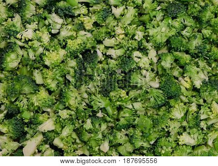 food background pattern - fresh raw sliced broccoli, prepared for cooking - bio healthy green food concept