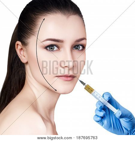 Beautiful woman gets injection in her lips. Isolated over white background. Plastic surgery and beauty concept.