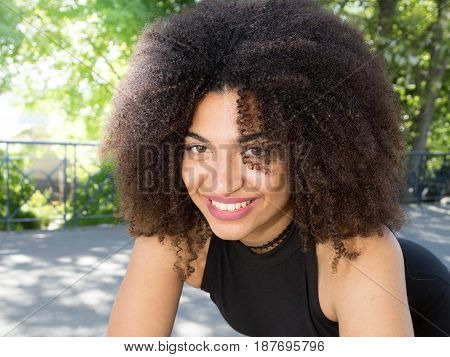 a black charming girl with curly hair