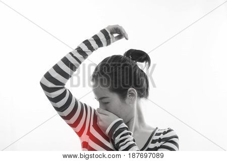 young asian woman having stink of sweat on isolated white background.