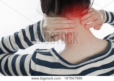 young woman having neck pain on isolated white background concept of office syndrome. view from back body.