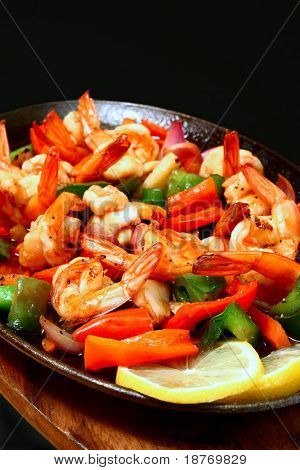spicy prawns served on sizzling plate
