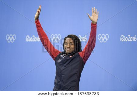 Rio de Janeiro Brazil - august 13 2016: Simone Manuel (USA) gold metal during medal ceremony after Women's 50 metre freestyle of the Rio 2016 Olympics