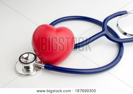 red heart and a stethoscope on white background health care medical technology concept soft focus selective focus.