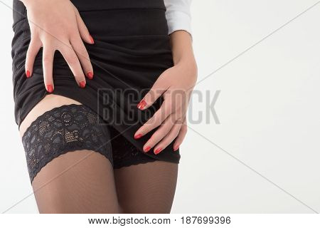 girl show her stockings on black background